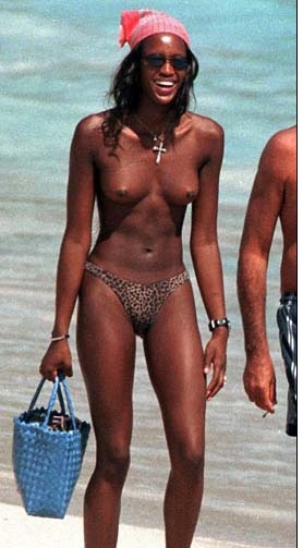Life is a beach for topless stars Naomi Campbell