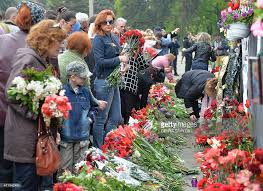 In Odessa people bring flowers to the House of trade unions in memory of the dead in 2014