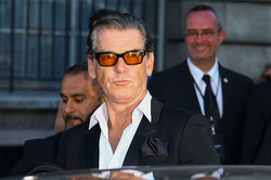Pierce Brosnan caught with a knife
